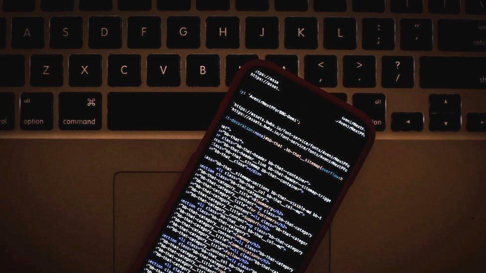 HTML code on an iPhone alongside a laptop, 22 January 2019