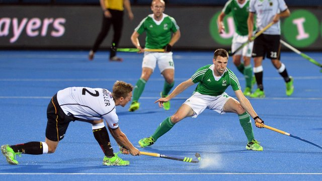 Germany's Mathias Muller competes against Ireland's Jonathan Bruton