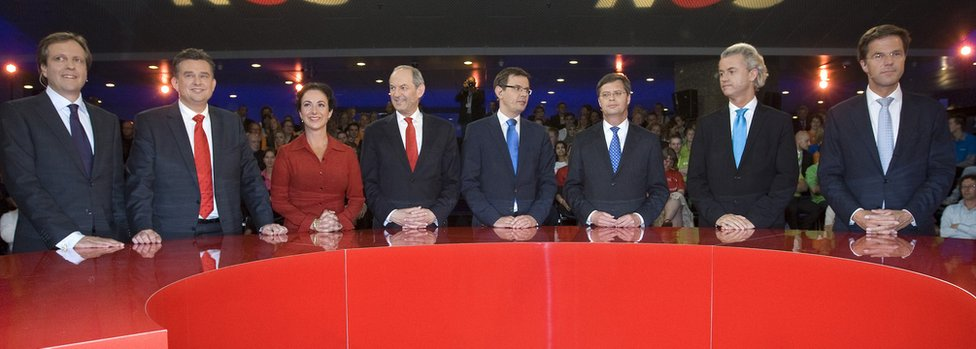 Dutch political party leaders (L-R) Alexander Pechtold from D66, Emile Roemer of the Socialist Party, Femke Halsema of the Green Party, Job Cohen from the Labour Party, Andre Rouvoet of the Christian Union, Jan Peter Balkenende of Christian Democrats, Geert Wilders of the Freedom Party and Mark Rutte of VVD stand prior to the debate on June 8, 2010 in The Hague. The leading candidates debate in the Dutch parliament in The Hague, the night before the elections.