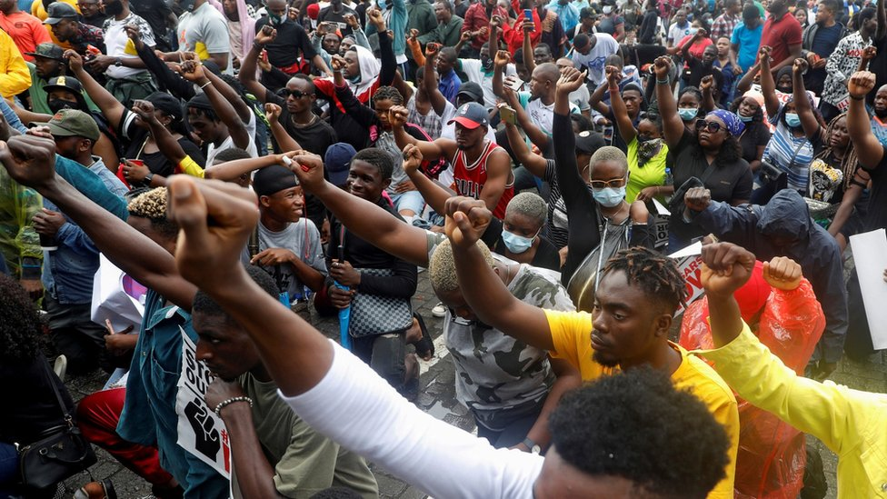 Demonstrators gesture during a protest over alleged police brutality, in Lagos, Nigeria, 14 October, 2020.