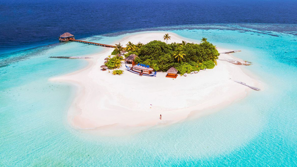 An aerial view of one of the 1200 islands making up the Maldives
