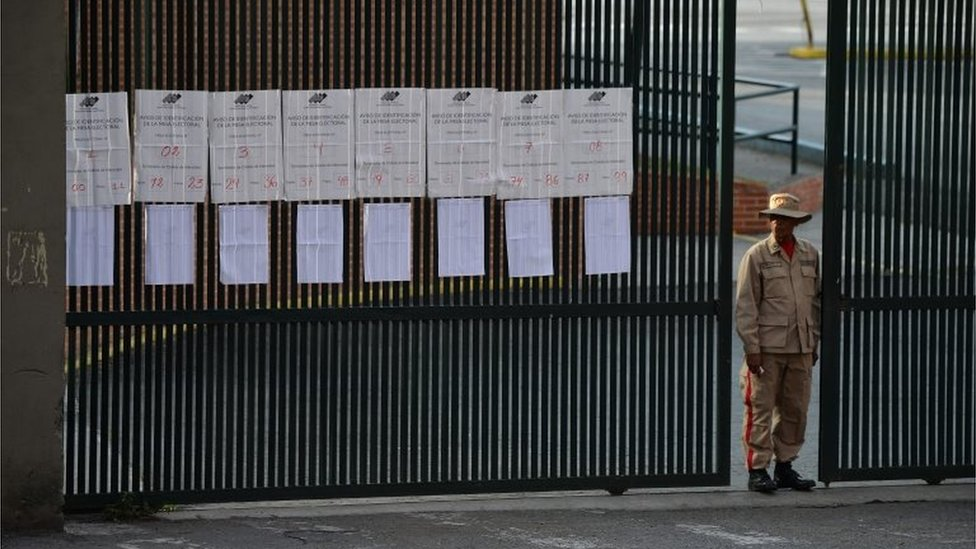A Bolivarian militia stands guard at the gate of a school in Caracas after polling stations closed on election day in Venezuela, on May 20, 2018.