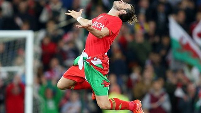 Wales goalscorer Gareth Bale celebrates at full-time as Wales qualify for Euro 2016
