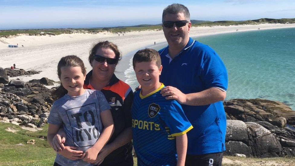 Derek Devoy with his wife and children