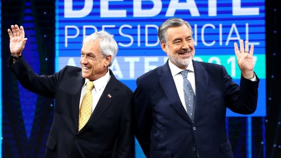 Chilean presidential candidates Alejandro Guillier and Sebastian Pinera attend a live televised debate in Santiago, Chile December 11, 2017