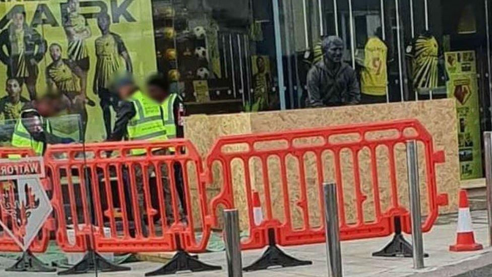 Statue being boarded up