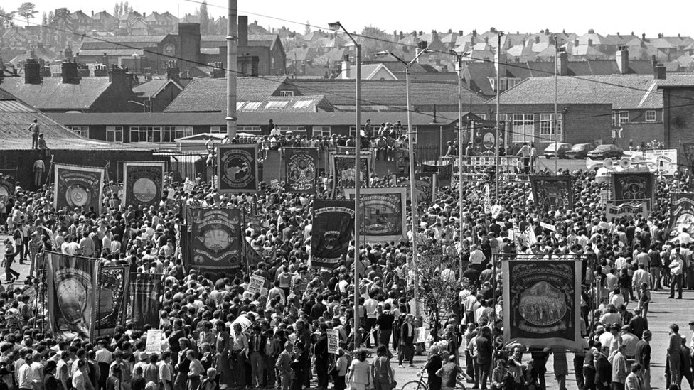 Striking miners march