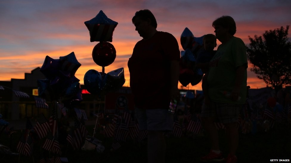 People pay tribute to the victims of a mass shooting in Tennessee