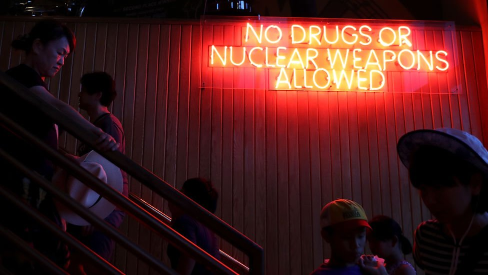 A neon sign in Guam makes light of recent nuclear tensions with North Korea
