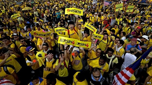 Protesters in yellow T-shirts