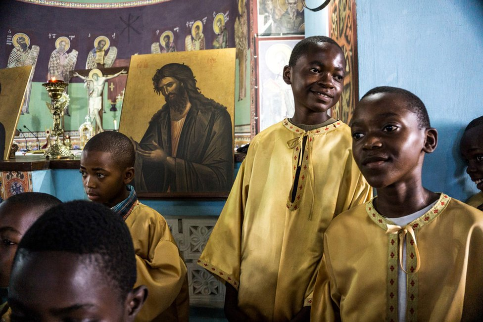 Congolese altar boys of the Greek Orthodox Church attend a Sunday mass at the Saint Andrew Cathedral in Kananga.