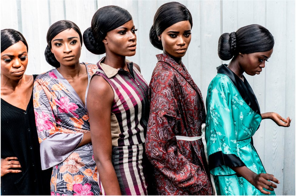 Models display their make up to stage managers and designers ahead of the final dressing up at the Africa Fashion Week in Lagos