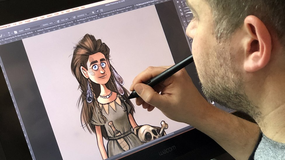 Artist Alex Leonard working on one of the characters