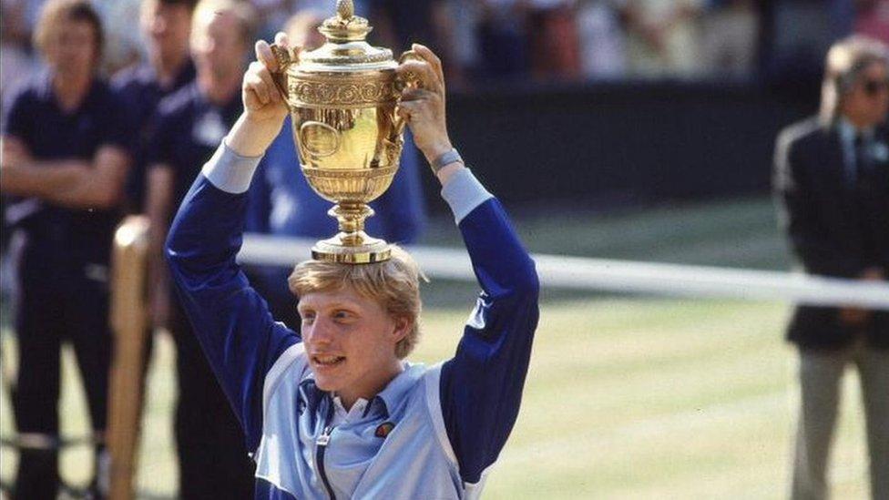 Boris Becker holds his 1985 Wimbledon men's singles trophy aloft
