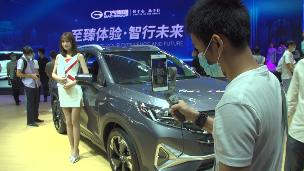 People at an autoshow in China