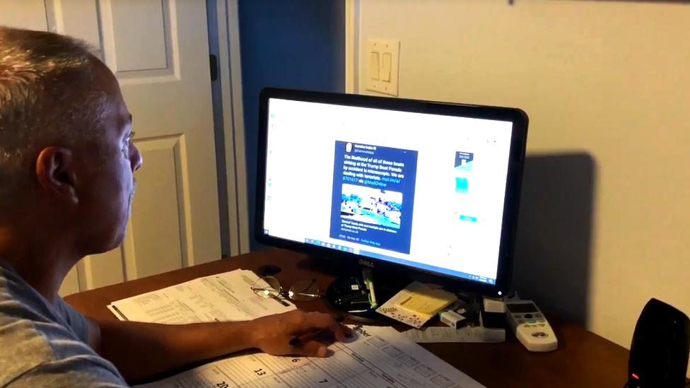 Tom Long at a computer