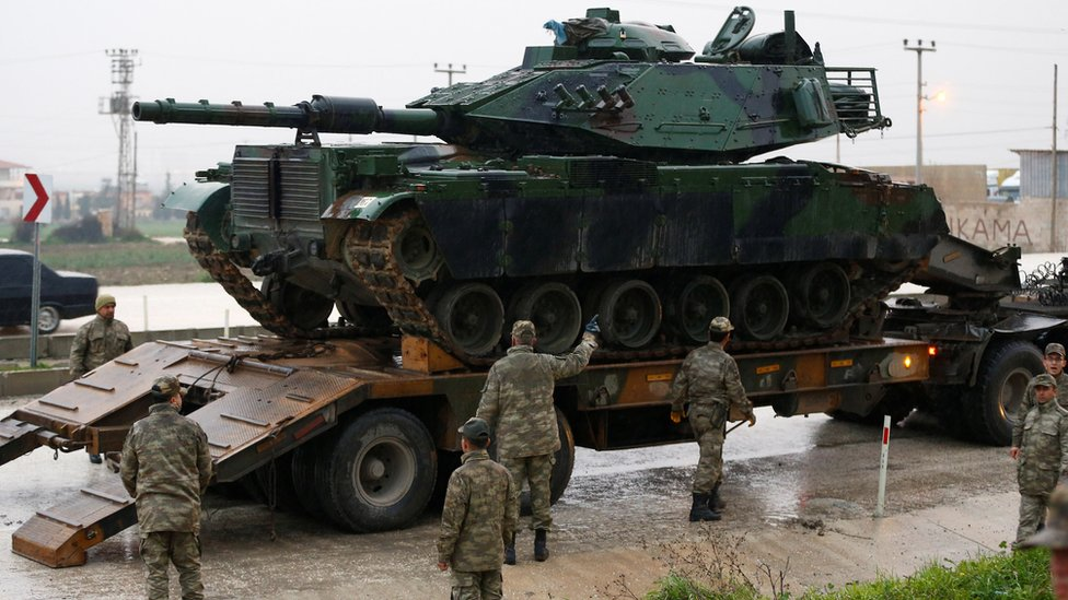 A Turkish tank arrives at an army base in the border town of Reyhanli