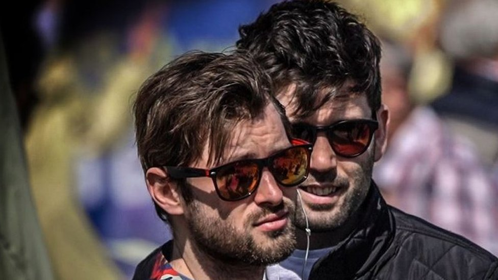 Two bearded men in sunglasses