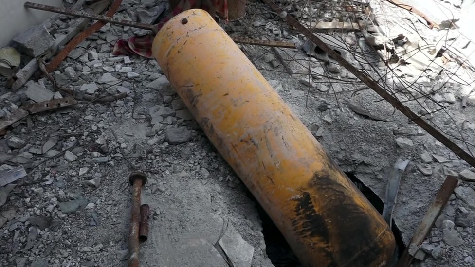 A yellow compressed gas canister found on the roof of what witnesses said was the building targeted in an alleged chemical weapons attack in Douma, Syria, on 7 April 2018