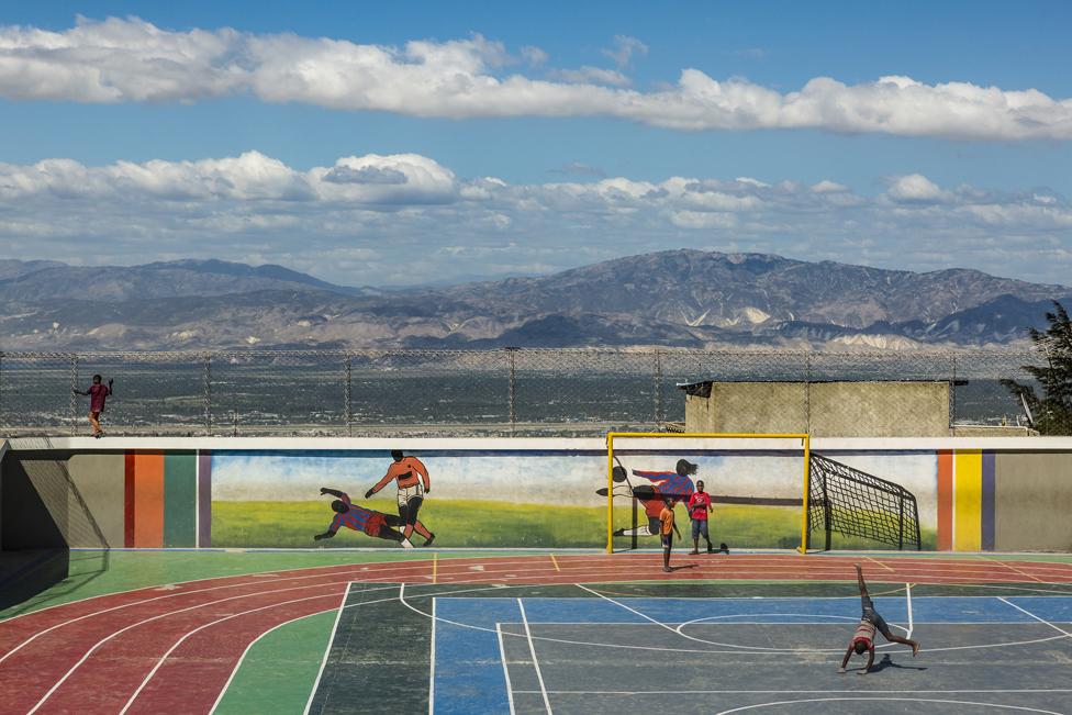 Children play at Jalousie's main sports arena