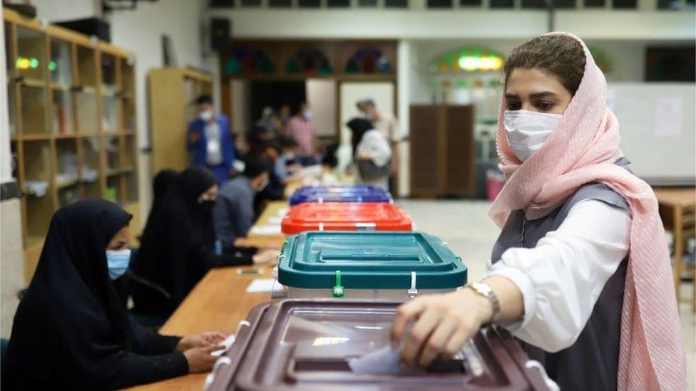 iranian woman votes in Tehran