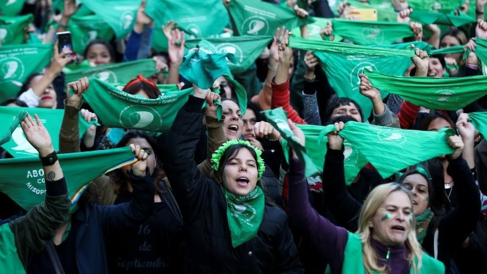 Activists hold green handkerchiefs, which symbolise the abortion rights movement, during a rally to legalise abortion, outside the National Congress in Buenos Aires, Argentina May 28, 2019