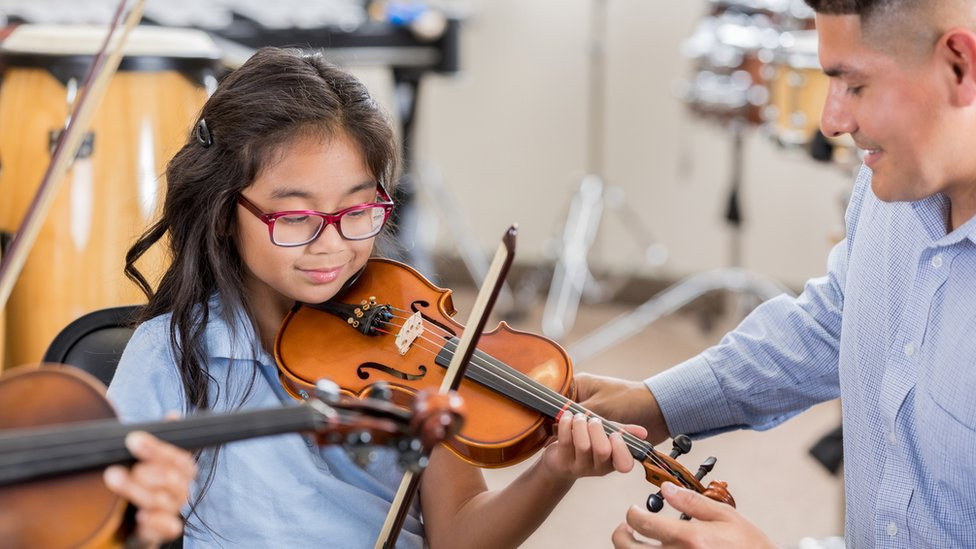 All school music lessons 'should be free', MSPs say