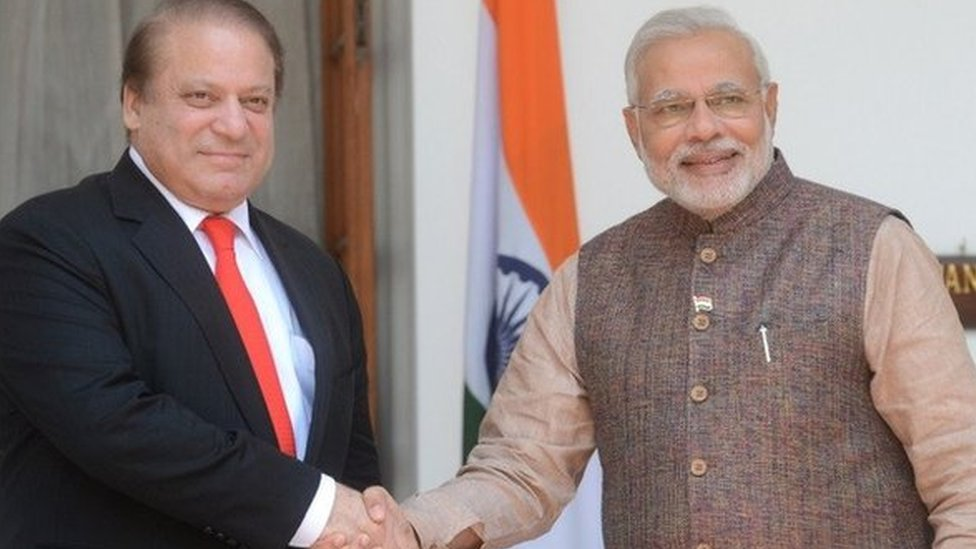 India's newly sworn-in Prime Minister Narendra Modi (R) shakes hands with Pakistani Prime Minister Nawaz Sharif during a meeting in New Delhi on May 27, 2014.