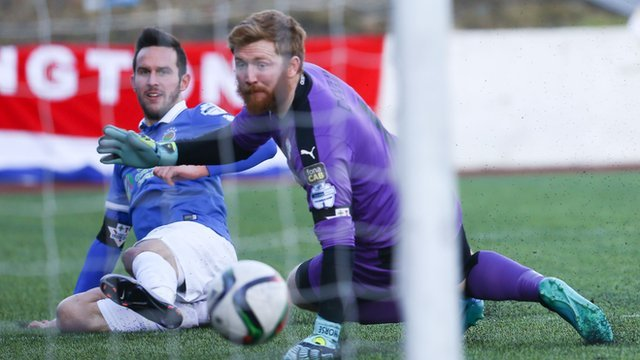 Linfield's Andrew Waterworth scores past Cliftonville's Conor Devlin
