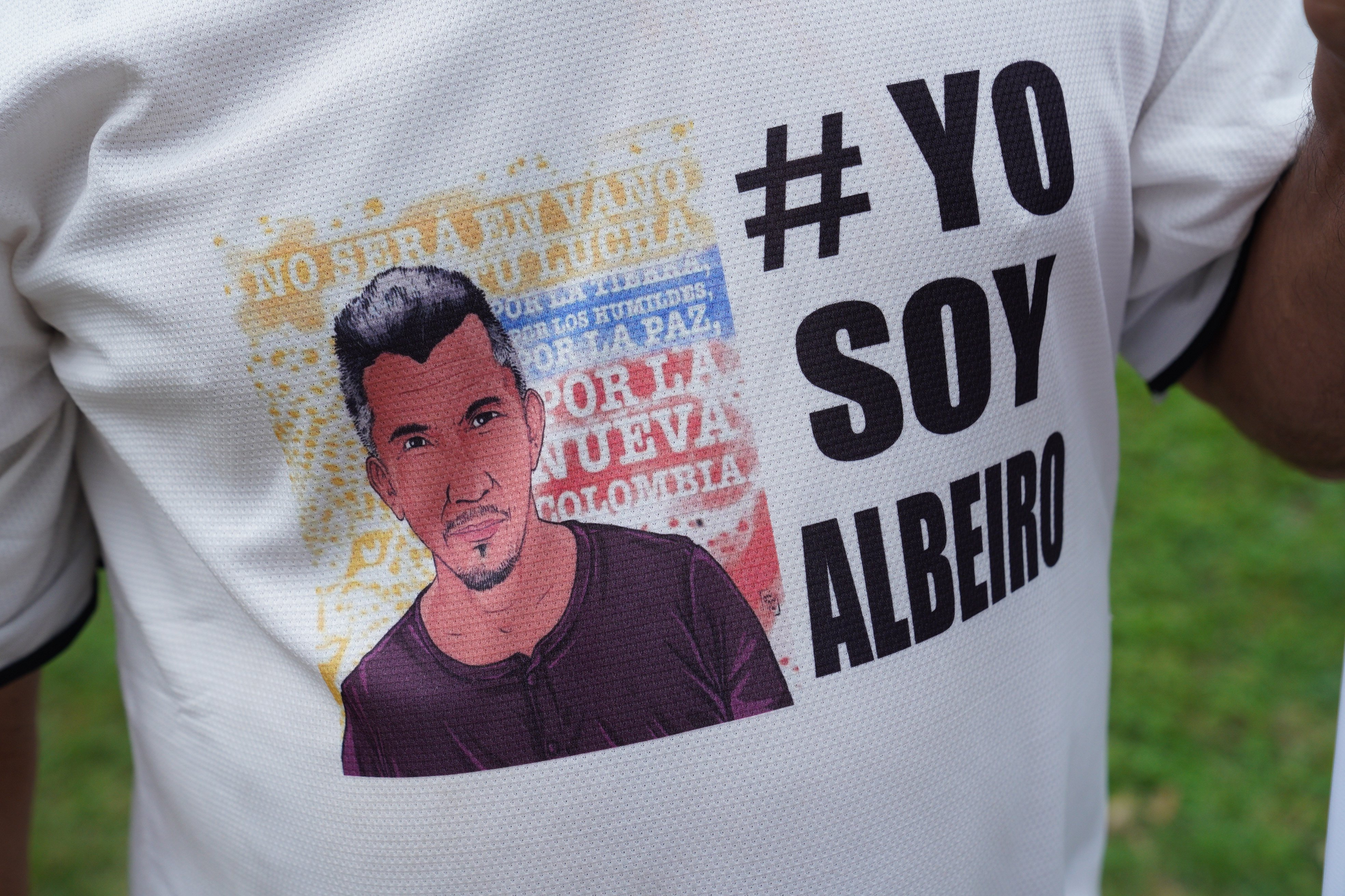 A former FARC fighter wears a t-shirt with the image of Juan de Jesus Monroy, also known as Albeiro, a FARC party leader murdered in October. The assassination unleashed Sunday's march on Bogota.