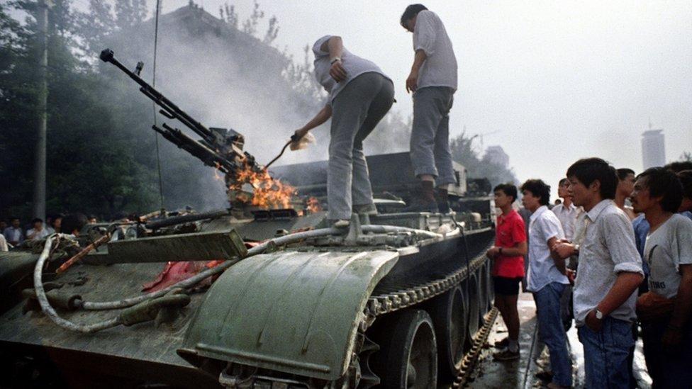 A burning APC on 4 June 1989 near Tiananmen Square