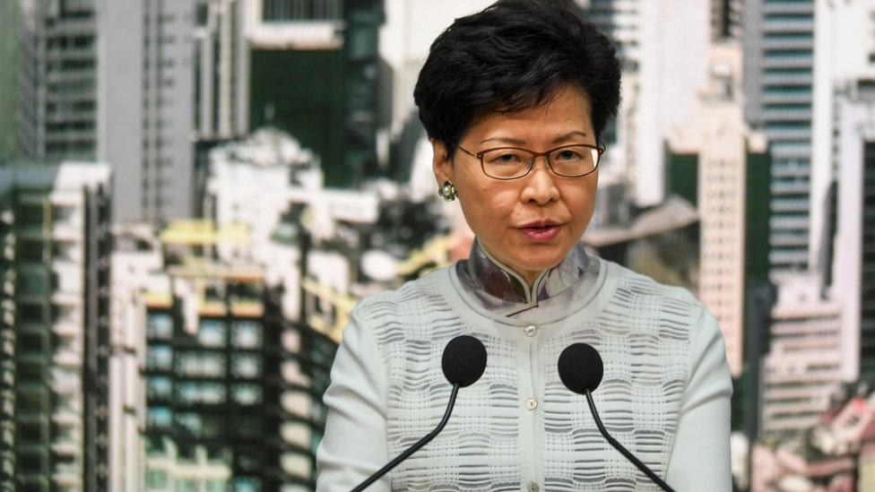 Carrie Lam speaking at a press conference