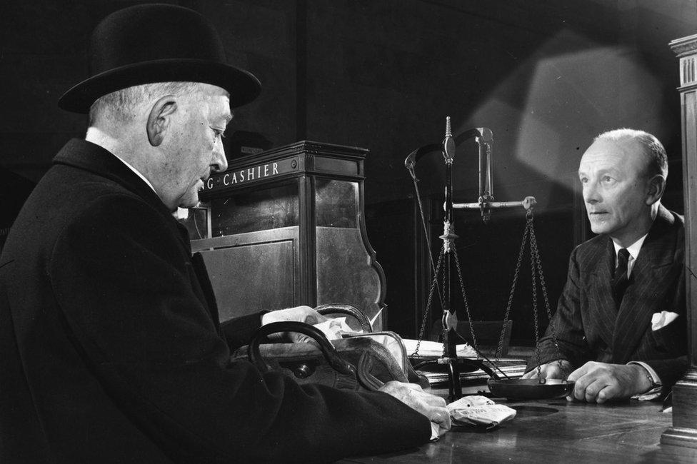1950s changing silver at bank counter