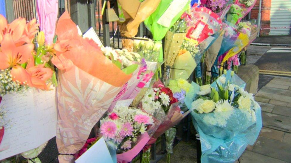 Flowers near the scene of Ian Ogle's murder