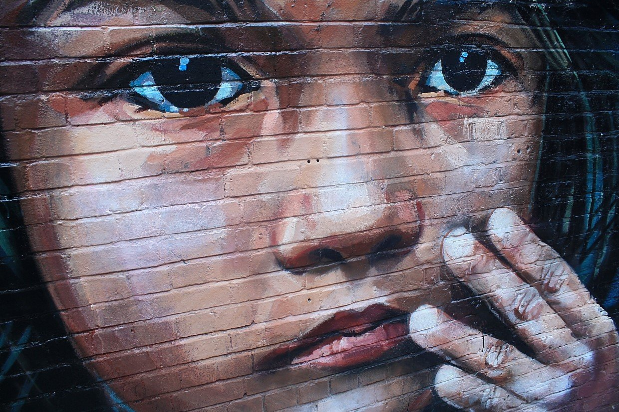Painting of a face on a wall