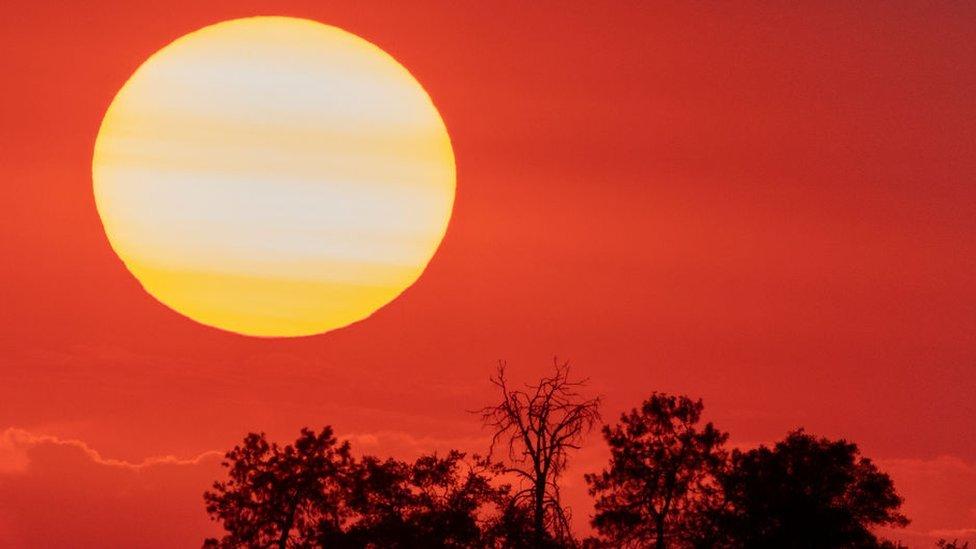 A picture of a blazing sun over California