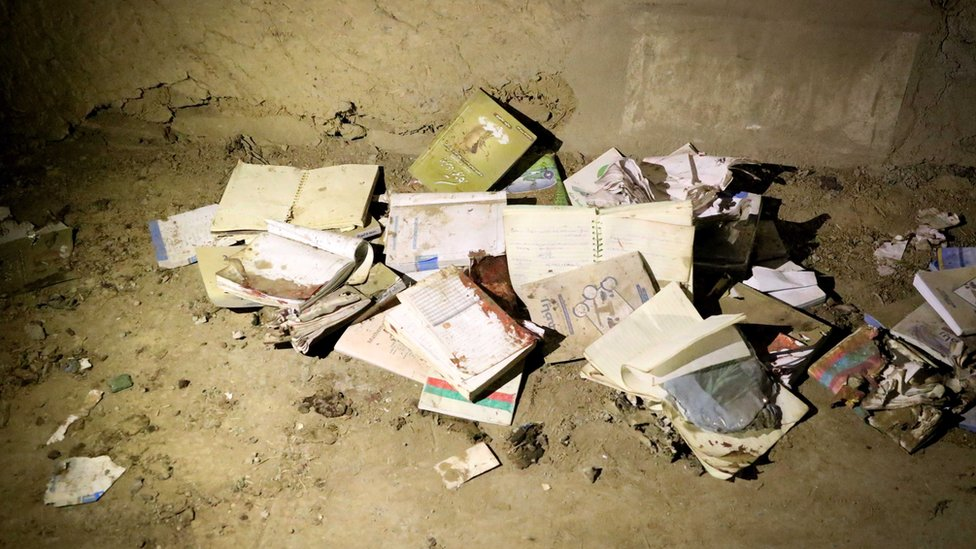 "Bloodstained books and notebooks of students are seen on the ground at the scene of a suicide attack that targeted an educational center ""Kohsar Danesh"" in Kabul, Afghanistan, 24 October 2020."