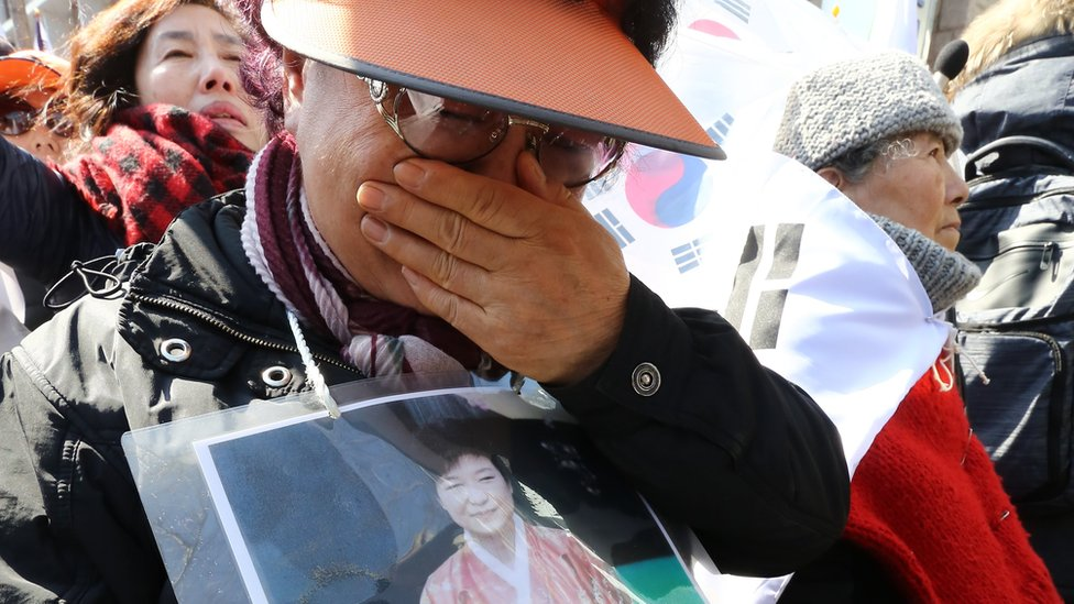 A supporter of impeached South Korean President Park Geun-hye reacts after the ruling by the Constitutional Court in Seoul, 10 March 2017
