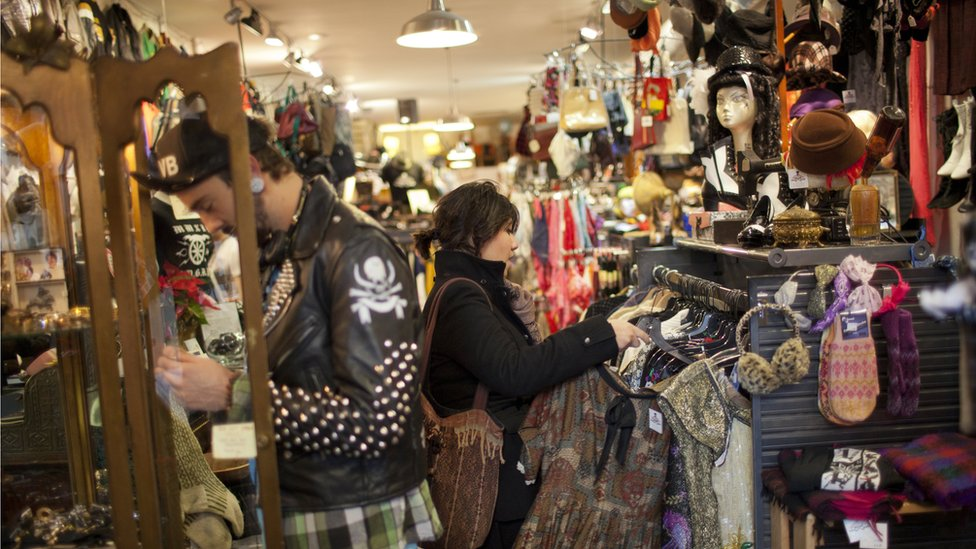 Denise Romero, a 21-year-old Mexican-American, looks for a blouse while shopping January 2, 2012 in a thrift store in Brooklyn, New York.