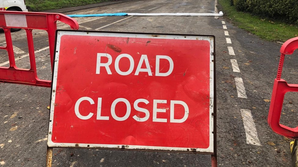 The road closure sign on the A140