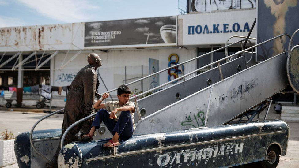 A boy at Hellenikon airport in Athens, where refugees and migrants are being housed temporarily
