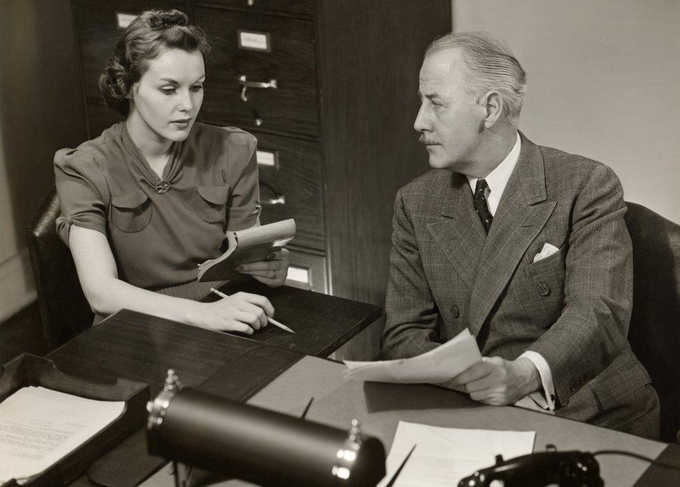 Male executive and female secretary, 1950s
