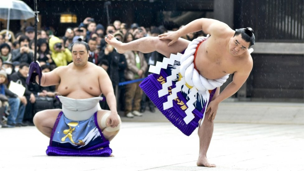 Sumo wrestlers performing a special ritual before a match