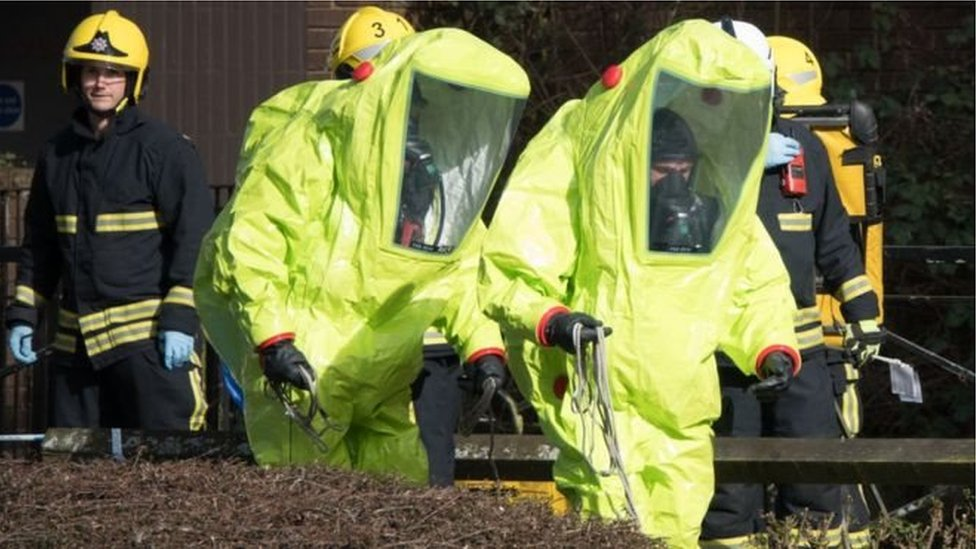 Specialist officers in protective suits
