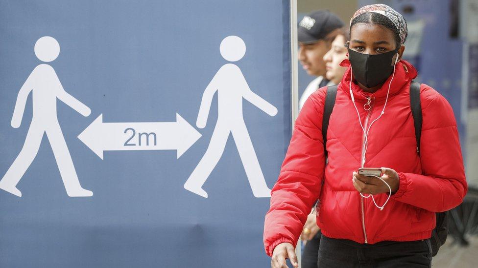 Woman wearing face mask in Leeds
