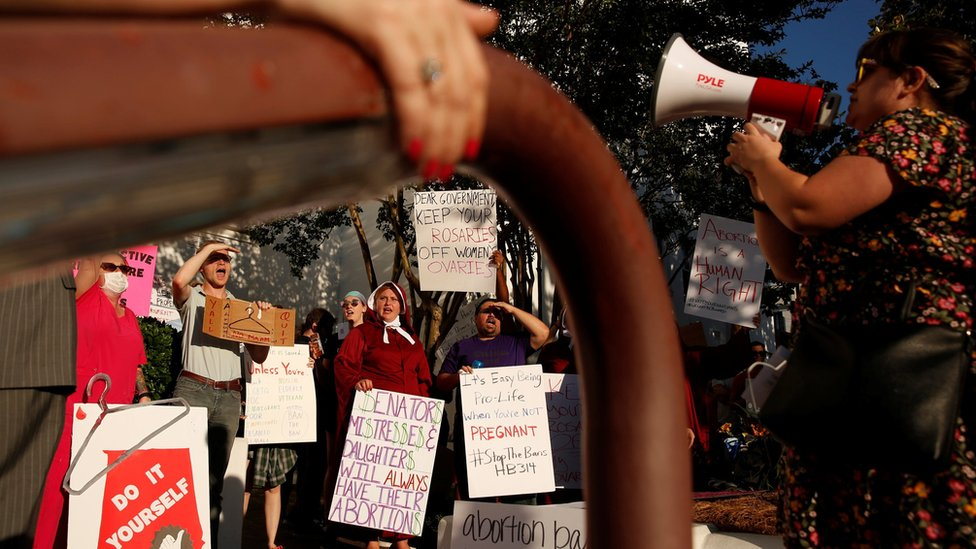 Pro-choice supporters protest in front of the Alabama State House as Alabama state Senate votes on the strictest anti-abortion bill in the United States
