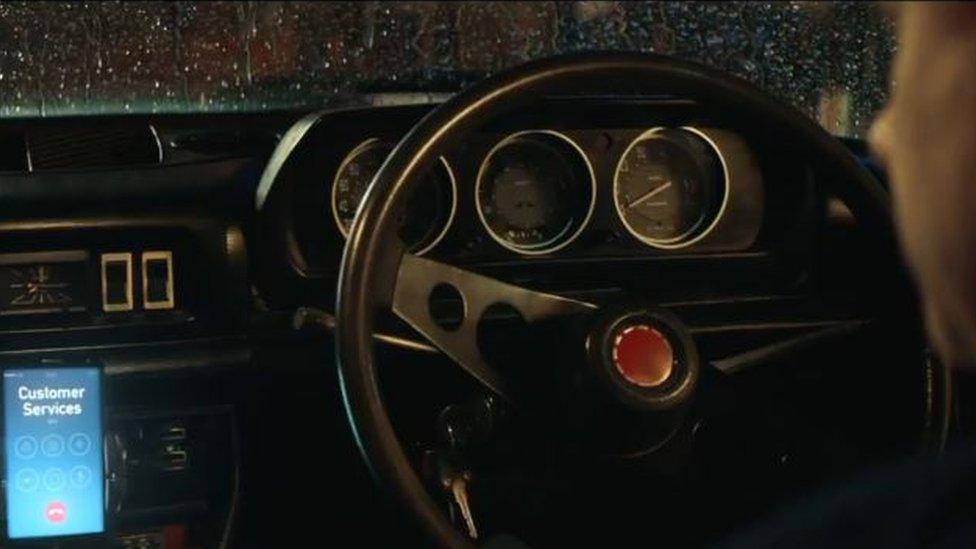 A mobile phone on a car dashboard