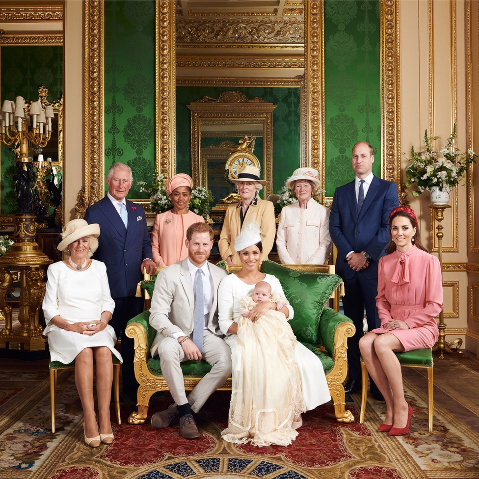 The Duke and Duchess of Sussex with their son, Archie and (left to right) the Duchess of Cornwall, The Prince of Wales, Doria Ragland, Lady Jane Fellowes, Lady Sarah McCorquodale, the Duke of Cambridge and the Duchess of Cambridge in the Green Drawing Room at Windsor Castle following Archie's christening.