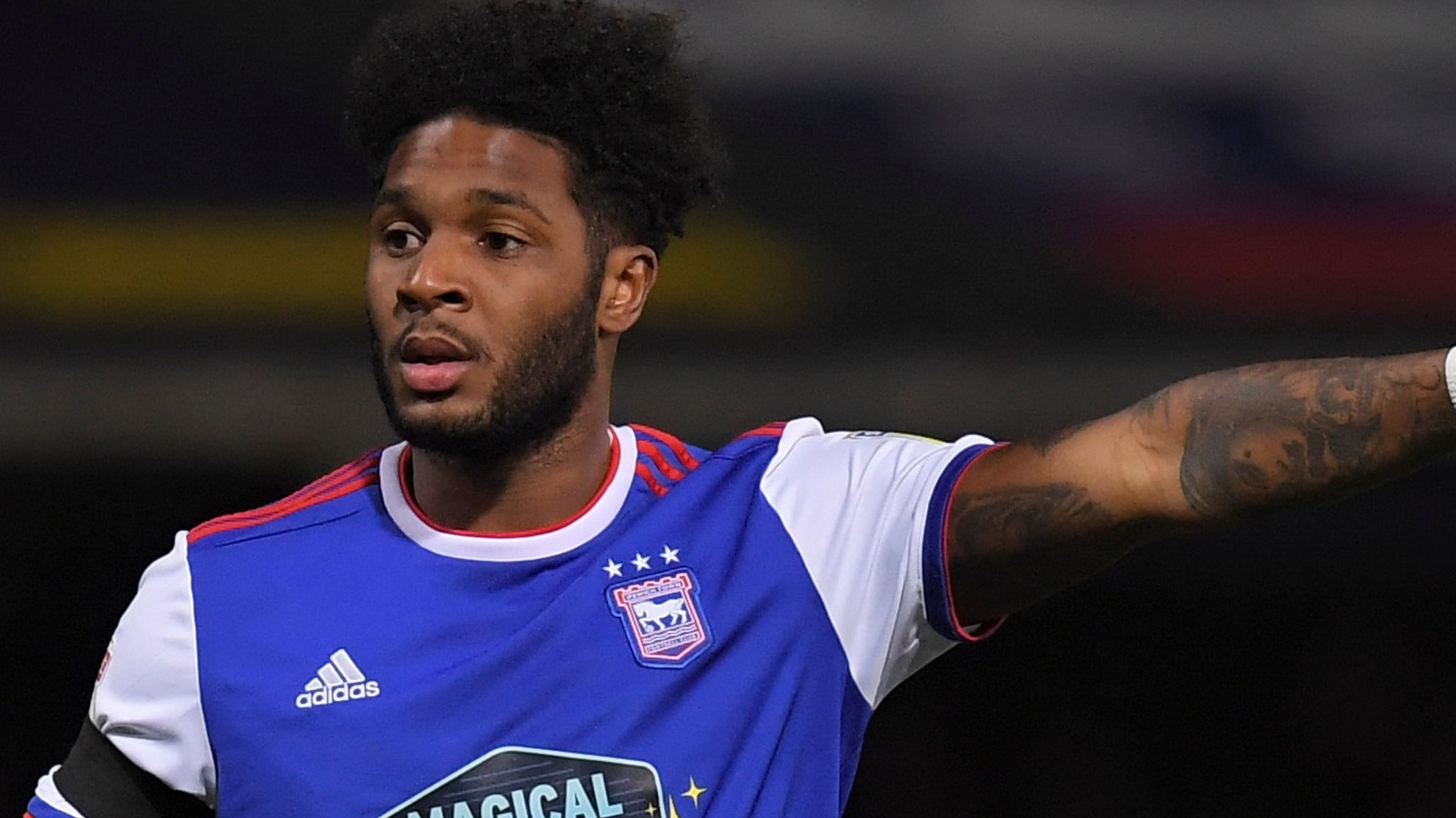 Ellis Harrison and Paul Downing: Portsmouth sign Ipswich Town striker and Blackburn defender