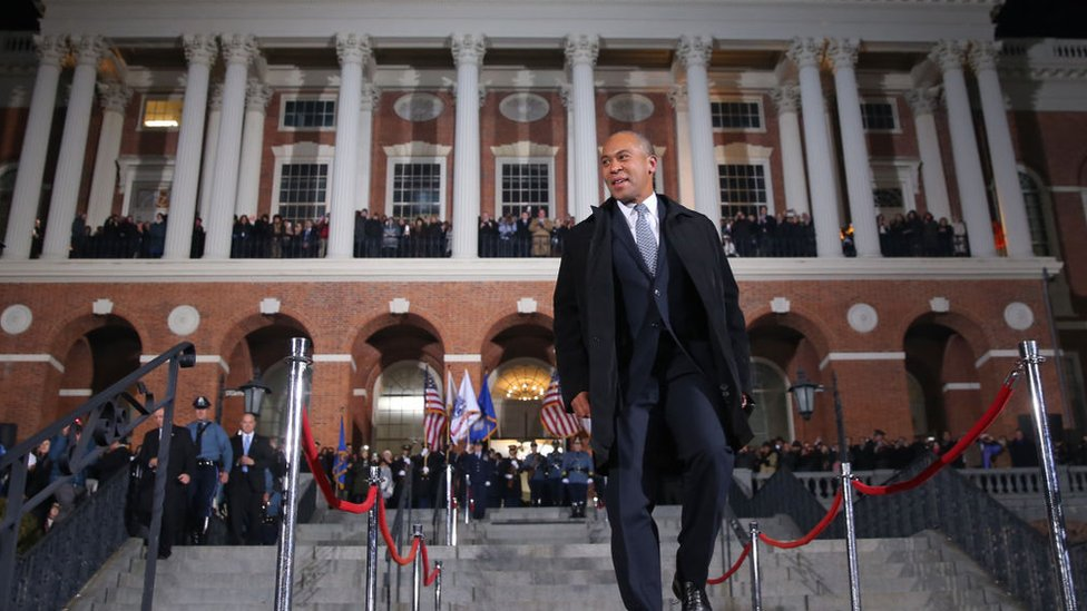 Then-Massachusetts Governor Deval Patrick leaves the state house in January 2015